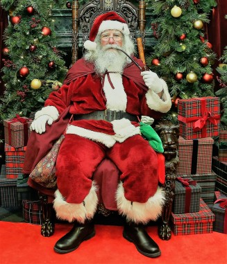 NEW YORK, NY - DECEMBER 13: Santa Claus attends an evening hosted by Brooks Brothers to celebrate the holidays with St. Jude Children's Research Hospital at Brooks Brothers on December 13, 2016 in New York City. (Photo by Bennett Raglin/Getty Images for Brooks Brothers)